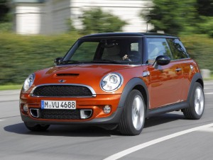 28 girls cram into a Mini for world record