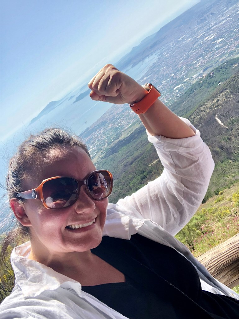 Delighted after climbing Mount Vesuvius in Pompeii, Italy