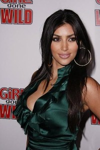 Curvy Kim Kardashian sparkles in new promo shots