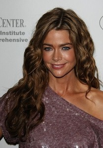 Denise Richards sizzles in black bikini
